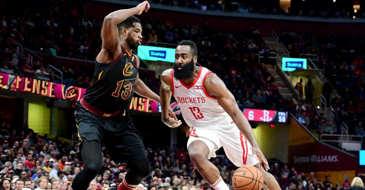 CLEVELAND, OH - NOVEMBER 24: Tristan Thompson #13 of the Cleveland Cavaliers tries to guard James Harden #13 of the Houston Rockets during the first half at Quicken Loans Arena on November 24, 2018 in Cleveland, Ohio. NOTE TO USER: User expressly acknowledges and agrees that, by downloading and/or using this photograph, user is consenting to the terms and conditions of the Getty Images License Agreement. (Photo by Jason Miller/Getty Images)