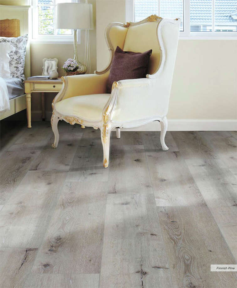 This vinyl flooring captures the rich look of real wood, right down to  the texture. But it's low maintenance, long-wearing vinyl instead. See  the Southwind collection at Southwest Floors, 1113 Andrews Highway, this  week. Photo: Courtesy