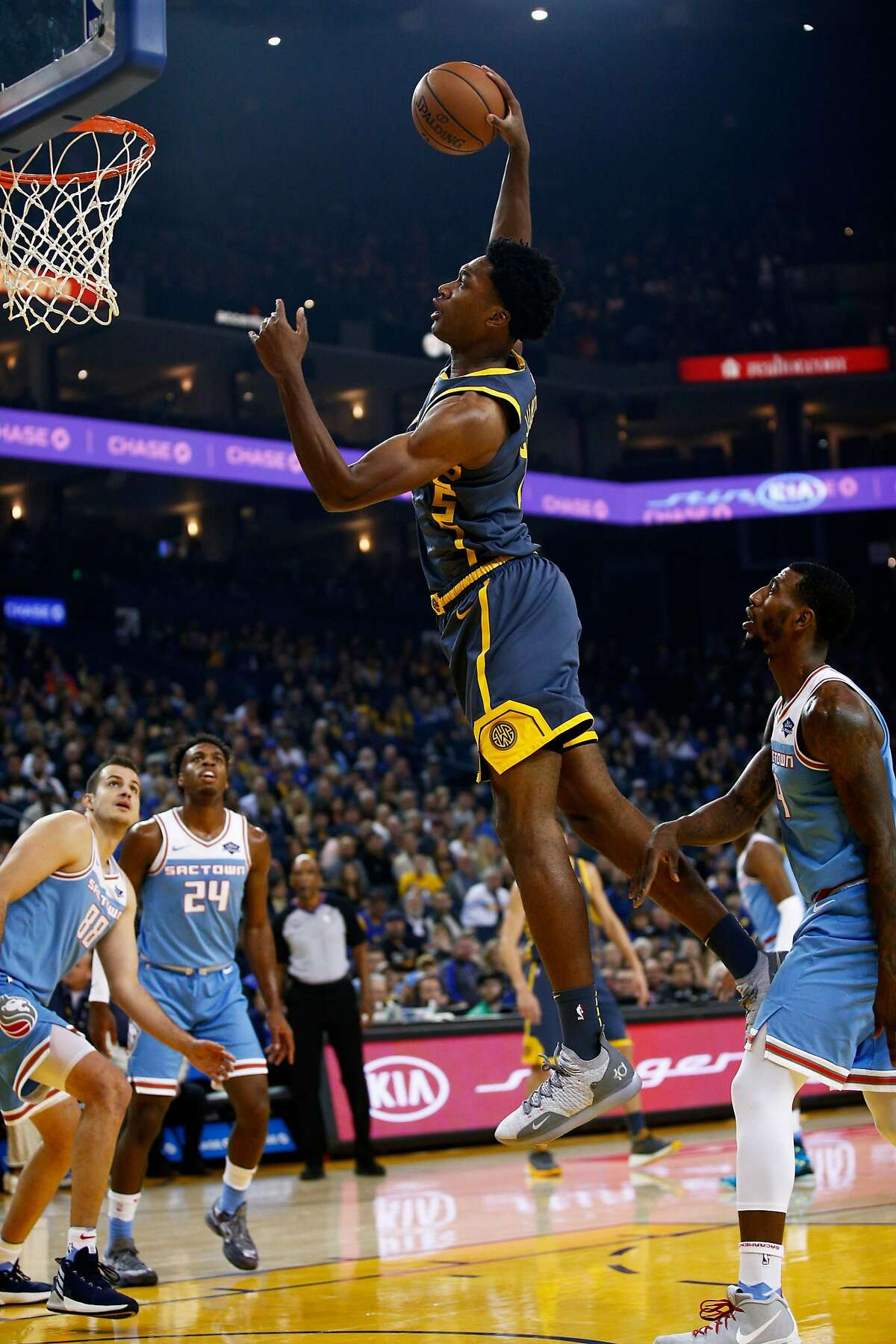 Golden State Warriors center Damian Jones (15) dunks in the first half of an NBA game at Oracle Arena on Saturday, Nov. 24, 2018, in Oakland, Calif.