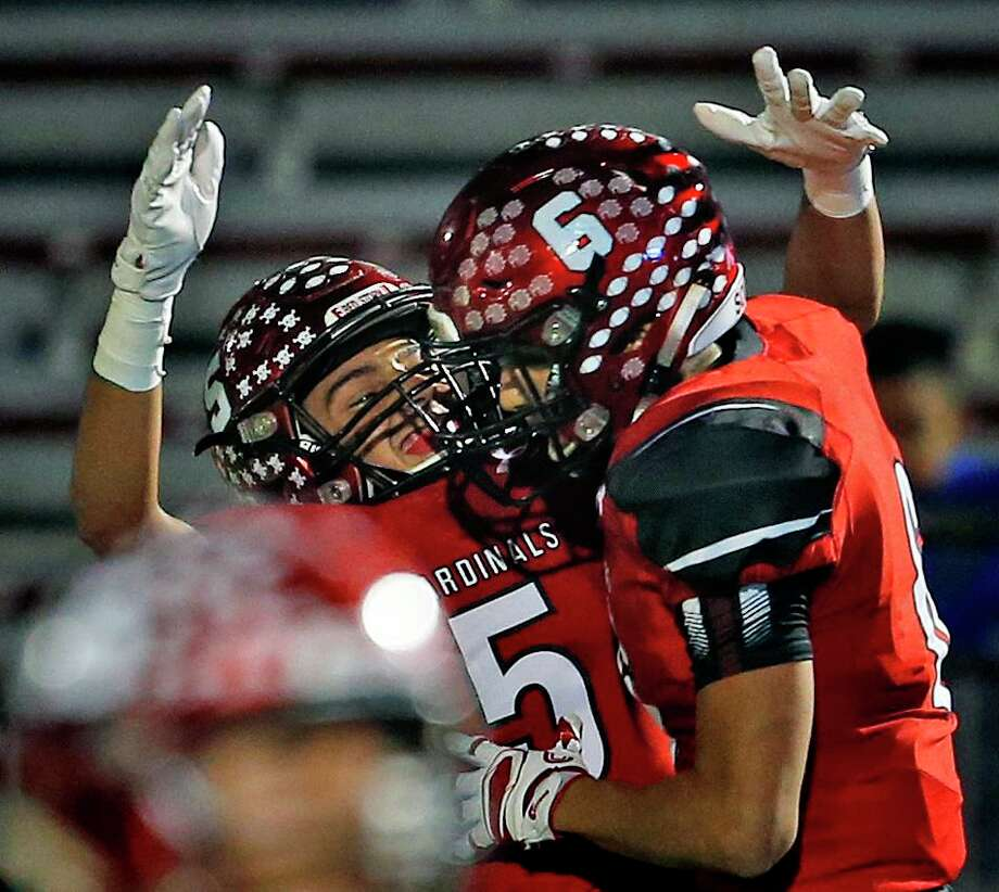 Southside's Christopher Camarillo, left, celebrates with Michael Hernandez after his touchdown  Saturday. Photo: Ronald Cortes /Contributor / / 2018 Ronald Cortes