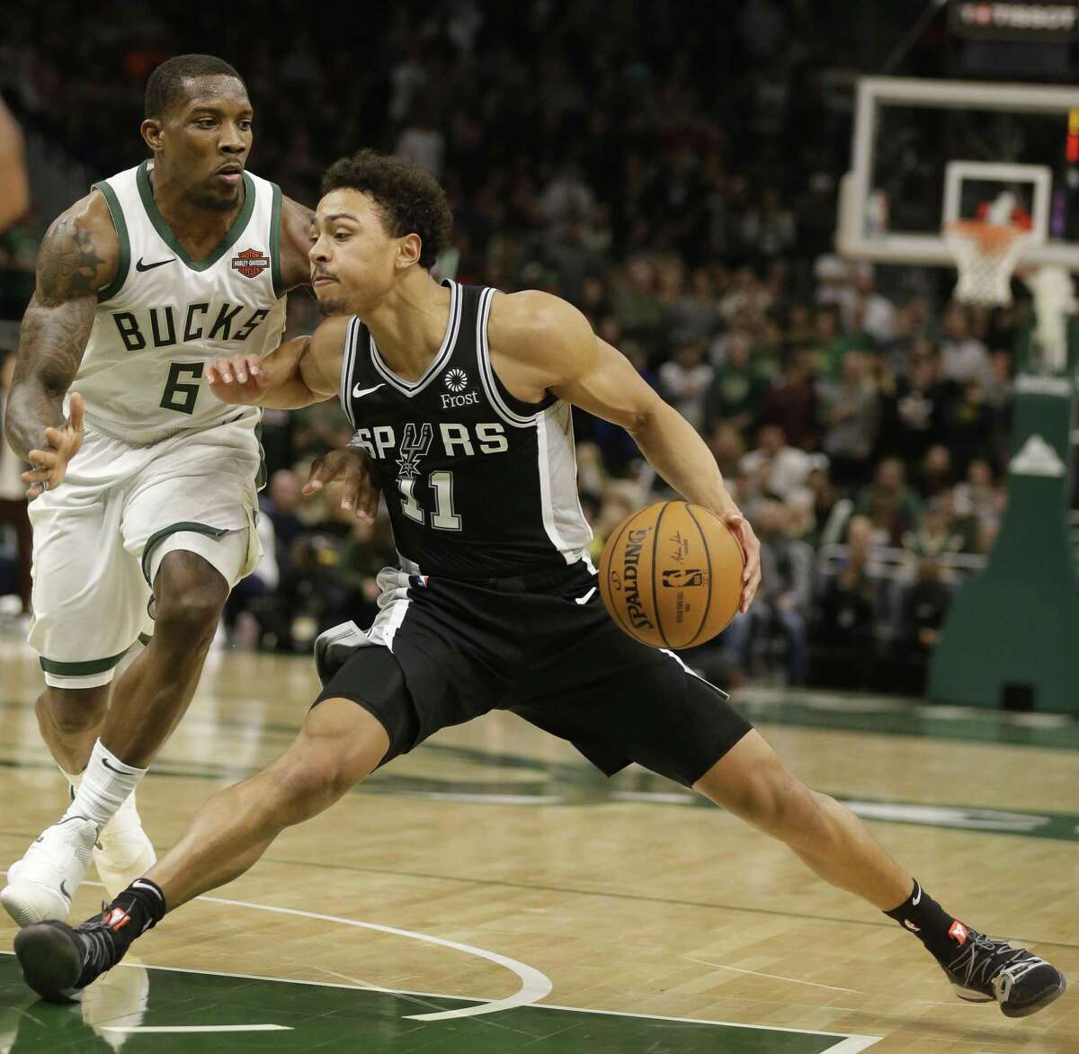 San Antonio Spurs' Bryn Forbes, right, drives against the Milwaukee Bucks' Eric Bledsoe during the second half of an NBA basketball game Saturday, Nov. 24, 2018, in Milwaukee. (AP Photo/Jeffrey Phelps)