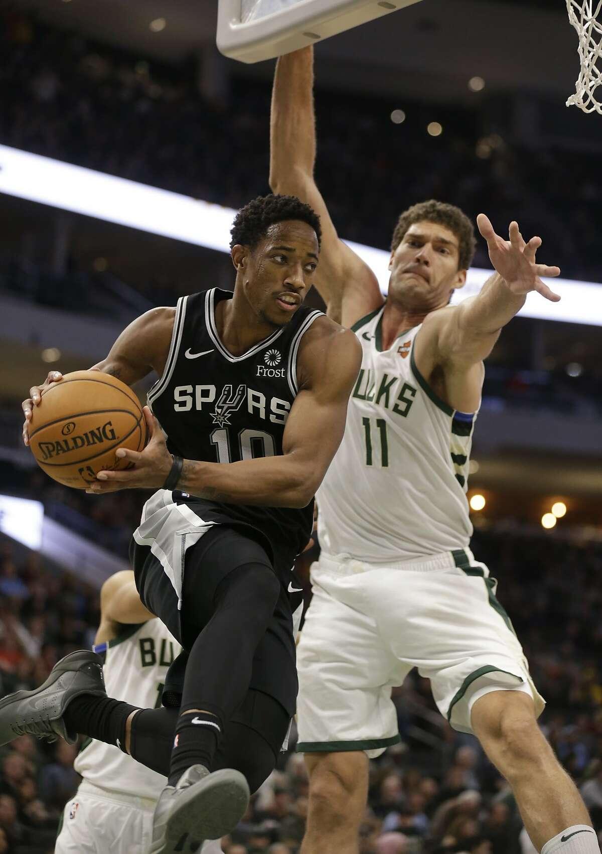San Antonio Spurs' DeMar DeRozan(10) drives against the Milwaukee Bucks' Brook Lopez during the second half of an NBA basketball game Saturday, Nov. 24, 2018, in Milwaukee. The Bucks won, 135-129. (AP Photo/Jeffrey Phelps)