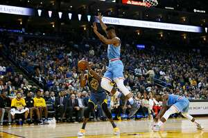 Golden State Warriors forward Kevin Durant (35) fakes a shot against Sacramento Kings forward Harry Giles (20) in the second half of an NBA game at Oracle Arena on Saturday, Nov. 24, 2018, in Oakland, Calif.