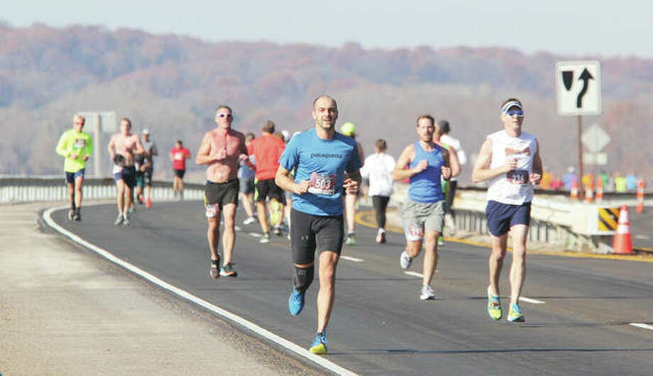Runners go in both directions near the half-way point during the 59th Annual Great River Road Run, held Saturday in Alton. The annual run featured a 10-mile run and a two-mile run/walk, with about 350 participating in the 10-mile run. Photo: Scott Cousins | The Telegraph