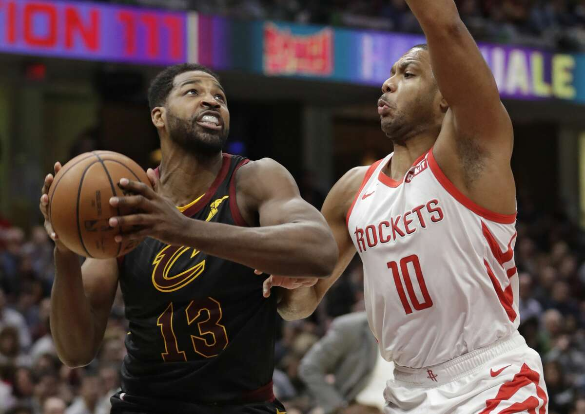 Cleveland Cavaliers' Tristan Thompson (13) drives to the basket against Houston Rockets' Eric Gordon (10) in the first half of an NBA basketball game, Saturday, Nov. 24, 2018, in Cleveland. (AP Photo/Tony Dejak)