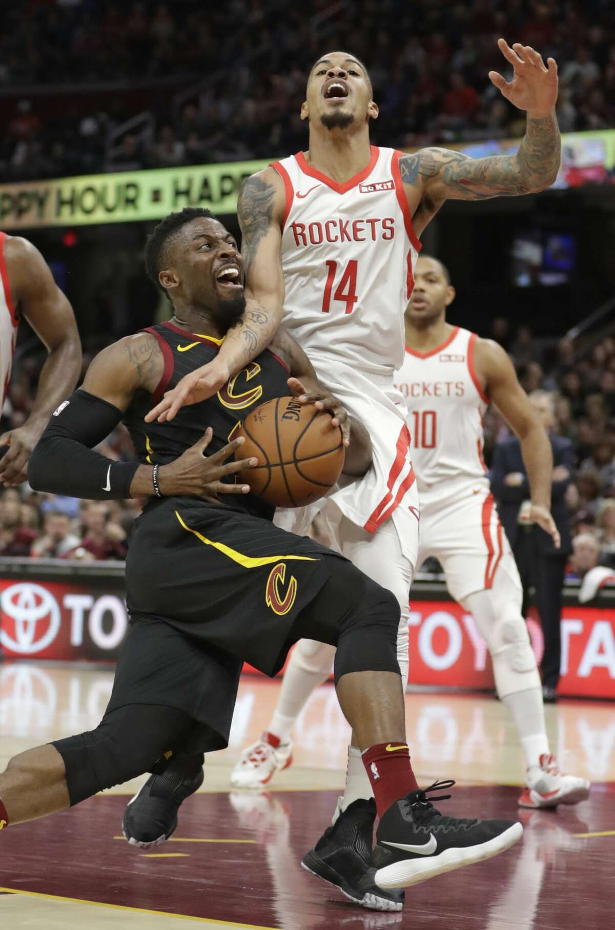 Cleveland Cavaliers' David Nwaba, left, drives past Houston Rockets' Gerald Green in the second half of an NBA basketball game, Saturday, Nov. 24, 2018, in Cleveland. Green was called for a foul. (AP Photo/Tony Dejak)