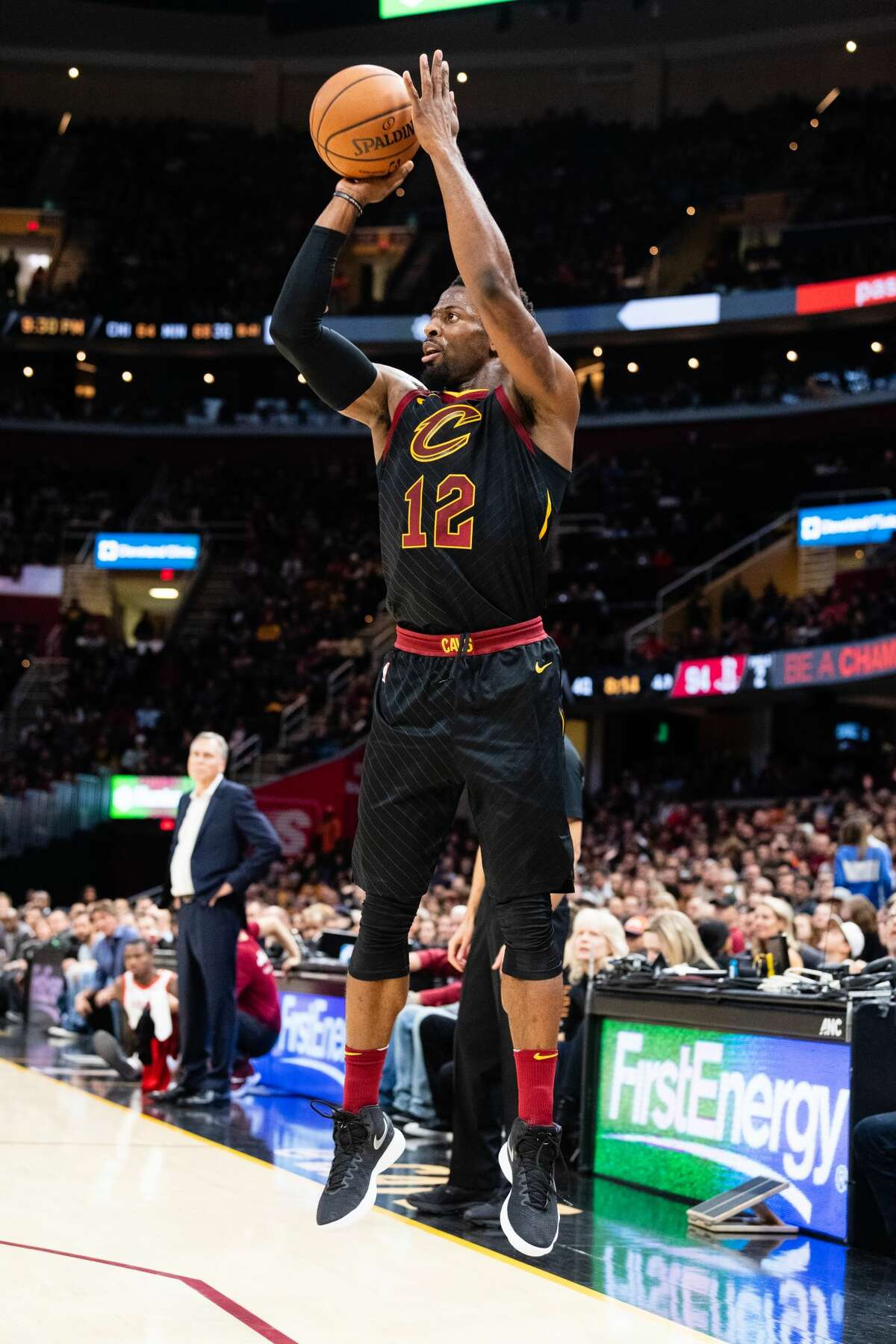 CLEVELAND, OH - NOVEMBER 24: David Nwaba #12 of the Cleveland Cavaliers shoots during the second half against the Houston Rockets at Quicken Loans Arena on November 24, 2018 in Cleveland, Ohio. The Cavaliers defeated the Rockets 117-108. NOTE TO USER: User expressly acknowledges and agrees that, by downloading and/or using this photograph, user is consenting to the terms and conditions of the Getty Images License Agreement. (Photo by Jason Miller/Getty Images)
