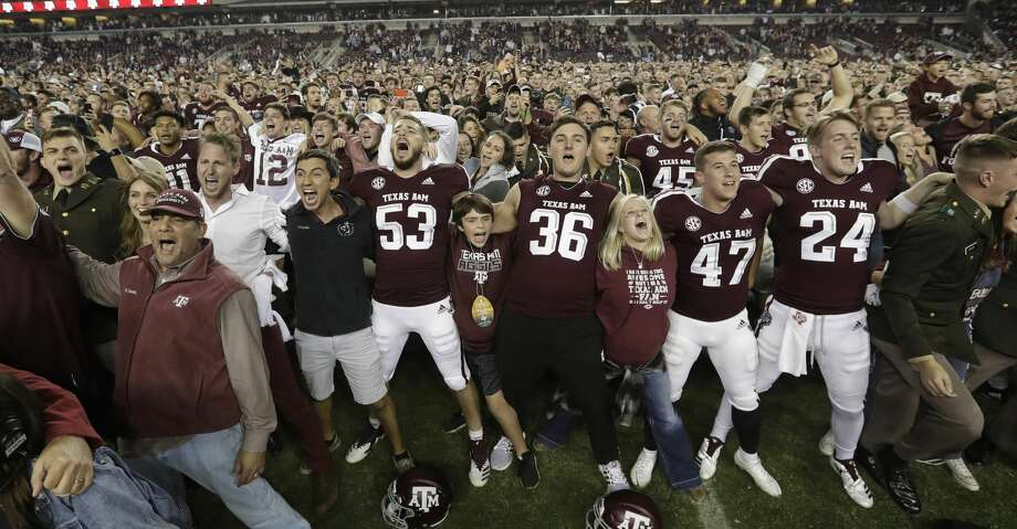 Fans and students join Texas A&M football players on the field after an NCAA college football game against LSU Saturday, Nov. 24, 2018, in College Station, Texas. Texas A&M won 74-72 in seven overtimes.(AP Photo/David J. Phillip) Photo: David J. Phillip/Associated Press