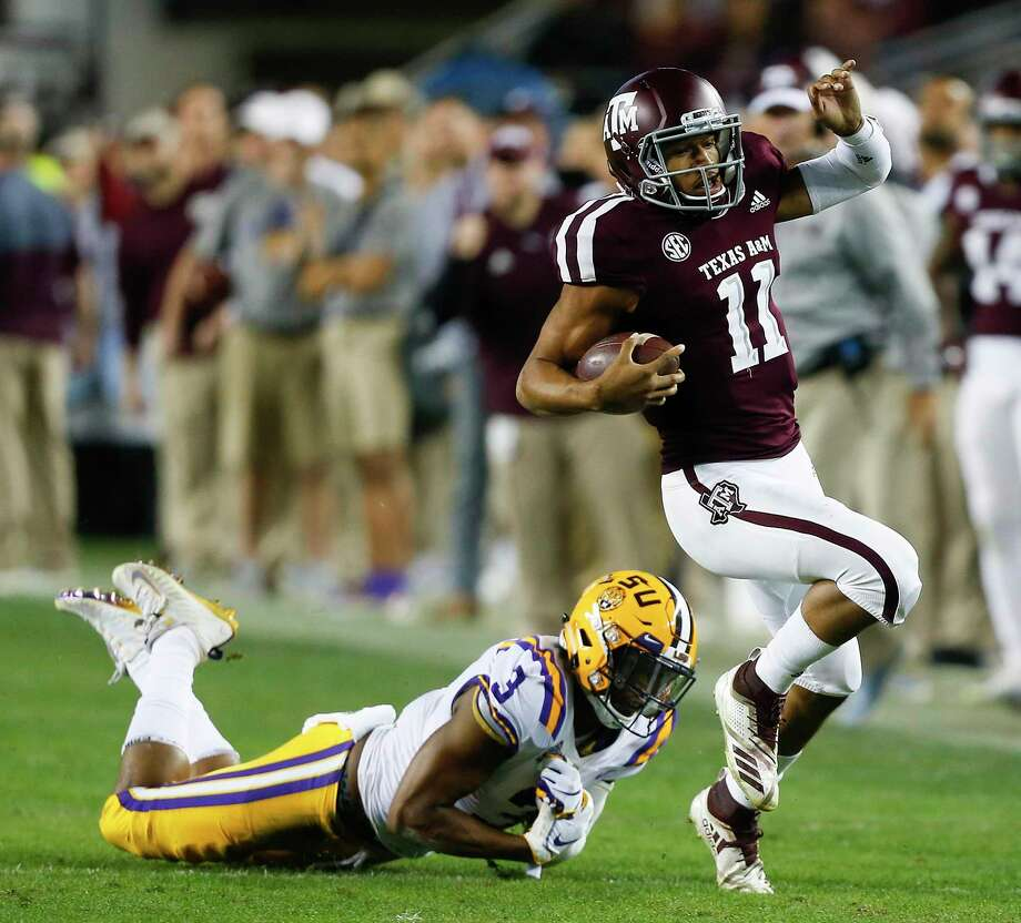 Texas A&M's Kellen Mond slips the tackle attempt by LSU's JaCoby Stevens during the first half at Kyle Field on Saturday. Photo: Bob Levey / Getty Images / 2018 Getty Images