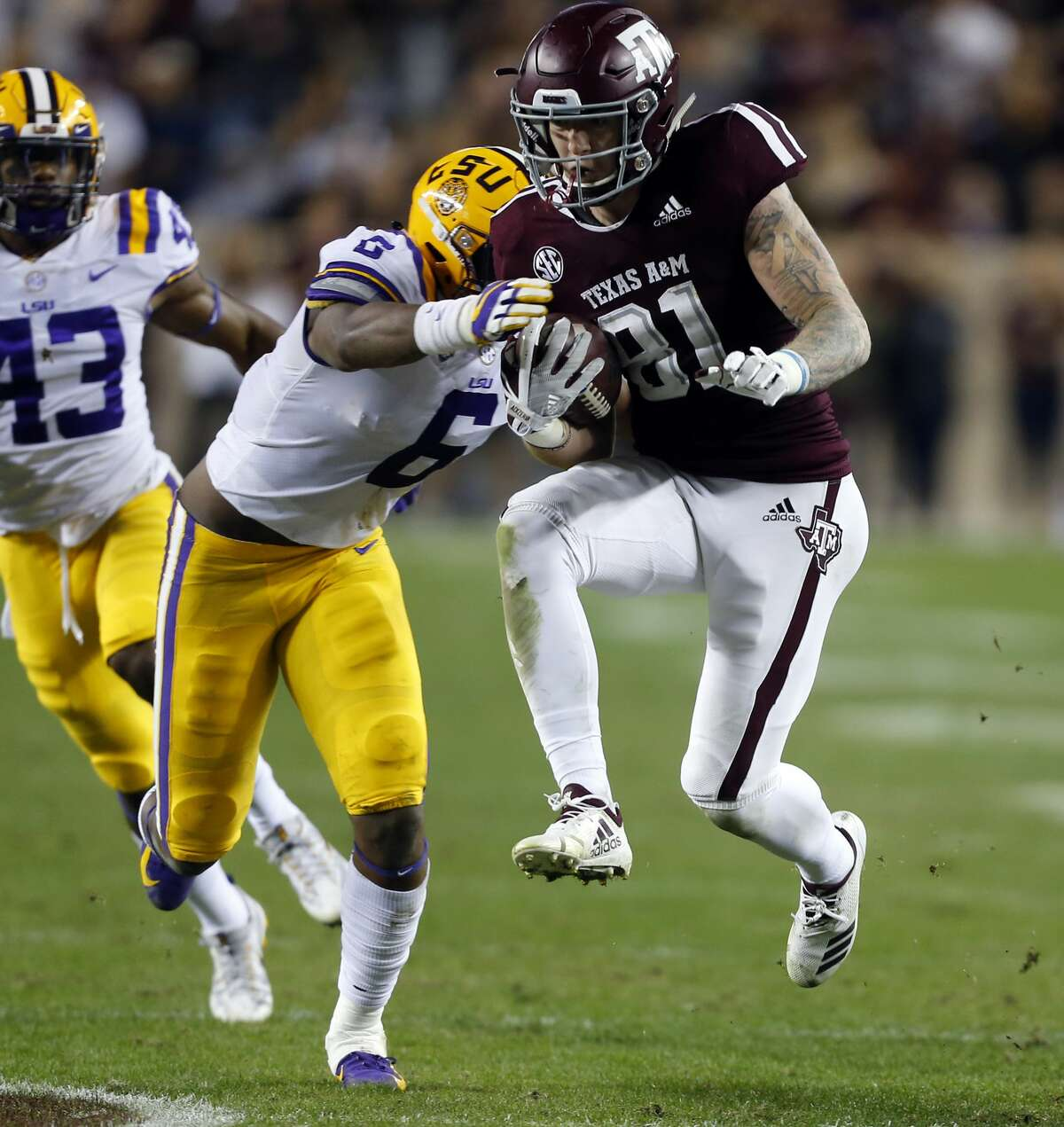 COLLEGE STATION, TEXAS - NOVEMBER 24: Jace Sternberger #81 of the Texas A&M Aggies runs past Jacob Phillips #6 of the LSU Tigers after a catch during the second quarter at Kyle Field on November 24, 2018 in College Station, Texas. (Photo by Bob Levey/Getty Images)