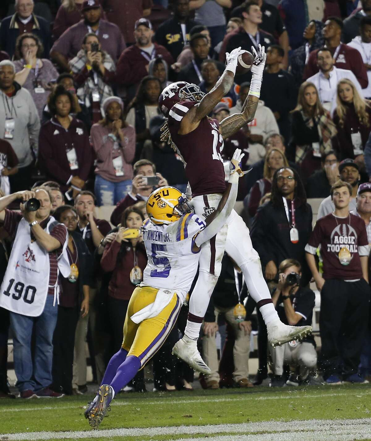 COLLEGE STATION, TEXAS - NOVEMBER 24: Kendrick Rogers #13 of the Texas A&M Aggies catches a pass for a touchdown in overtime as Kary Vincent Jr. #5 of the LSU Tigers defends as at Kyle Field on November 24, 2018 in College Station, Texas. (Photo by Bob Levey/Getty Images)