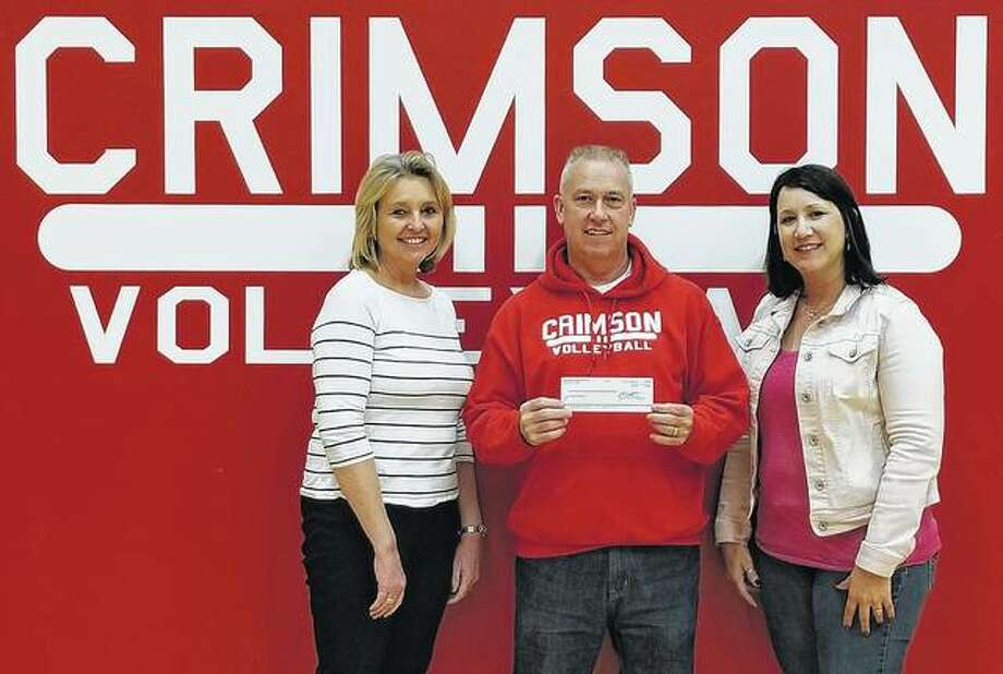 Jacksonville High School's volleyball program recently presented a $2,925 check to the Mia Ware Foundation. The funds were proceeds from JHS's Volley for A Cure match against Routt Catholic High School. Lisa Pennell (left) and Kim Brogdon (right), both of the Mia Ware Foundation, accepted the check from JHS volleyball coach Gary Hickox. Photo: Photo Provided