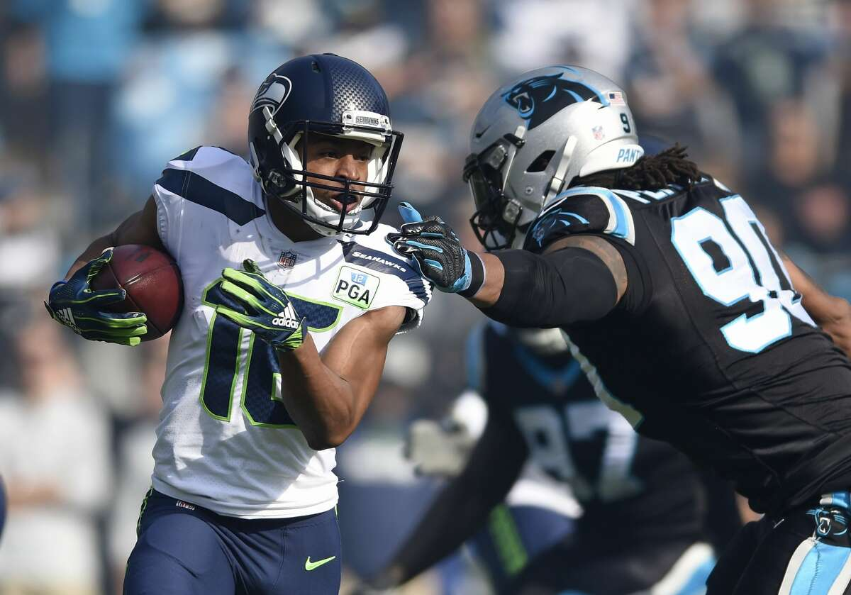 TYLER LOCKETT KEPT BALLING Tyler Lockett had a very efficient outing vs. the Panthers, hauling in five catches for 107 yards and a touchdown. It marked his first 100-yard receiving game of the season and fourth of his career.