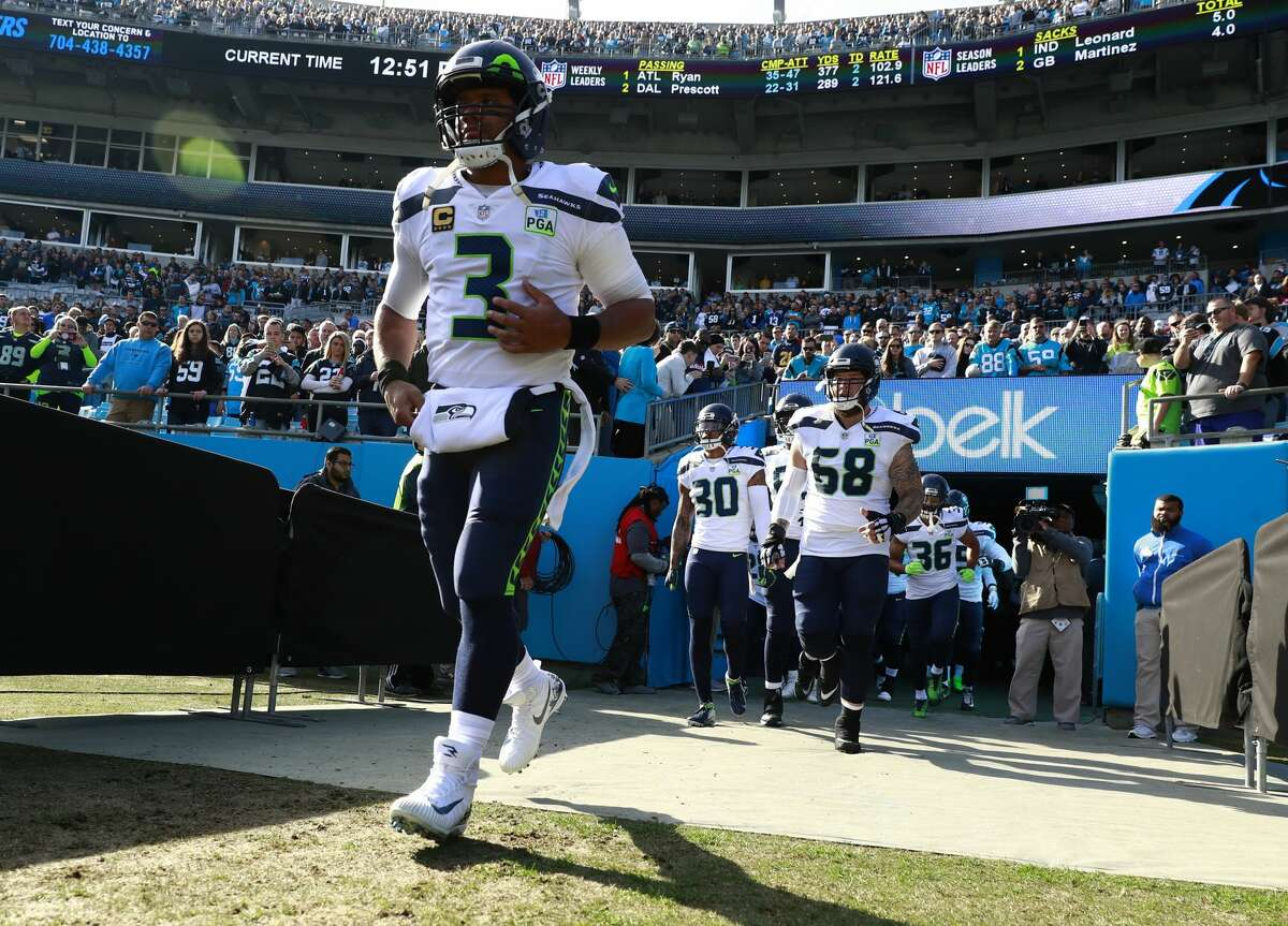 Seattle Seahawks' Russell Wilson (3) leads his team onto the field before an NFL football game against the Carolina Panthers in Charlotte, N.C., Sunday, Nov. 25, 2018. (AP Photo/Jason E. Miczek)