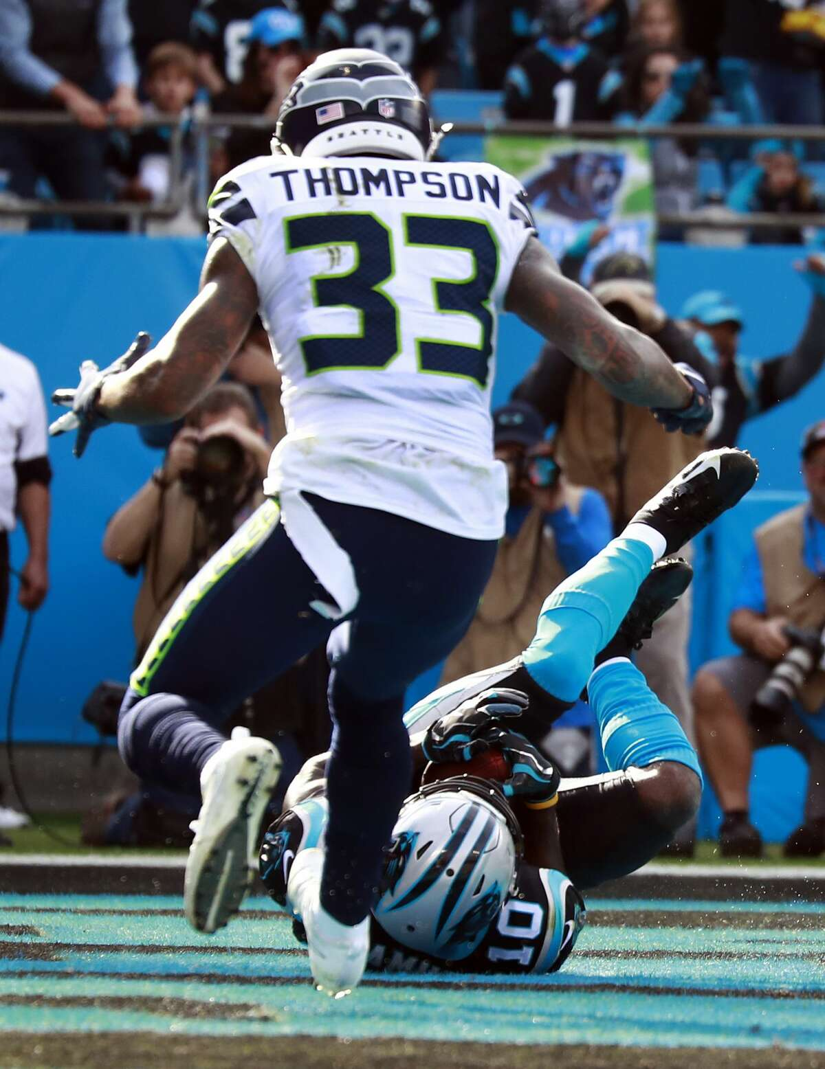 Carolina Panthers' Curtis Samuel (10) catches a touchdown pass against Seattle Seahawks' Tedric Thompson (33) during the first half of an NFL football game in Charlotte, N.C., Sunday, Nov. 25, 2018. (AP Photo/Jason E. Miczek)