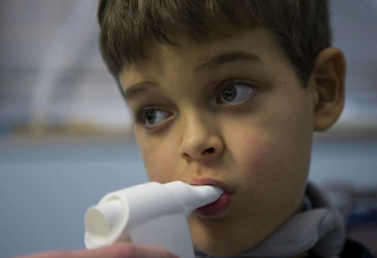 Seven-year-old Braden Scott blows into a device that helps him work on his breath support, which can help redevelop the muscles that help him swallow, during a speech therapy session with Jennifer Earnheart at TIRR Memorial Hermann in The Woodlands, Monday, Nov. 12, 2018. Two-years ago Braden was diagnosed with acute flaccid myelitis, or AFM. The polio-like illness has affected Braden's nervous system, causing muscle problems including having trouble swallowing, walking and writing.