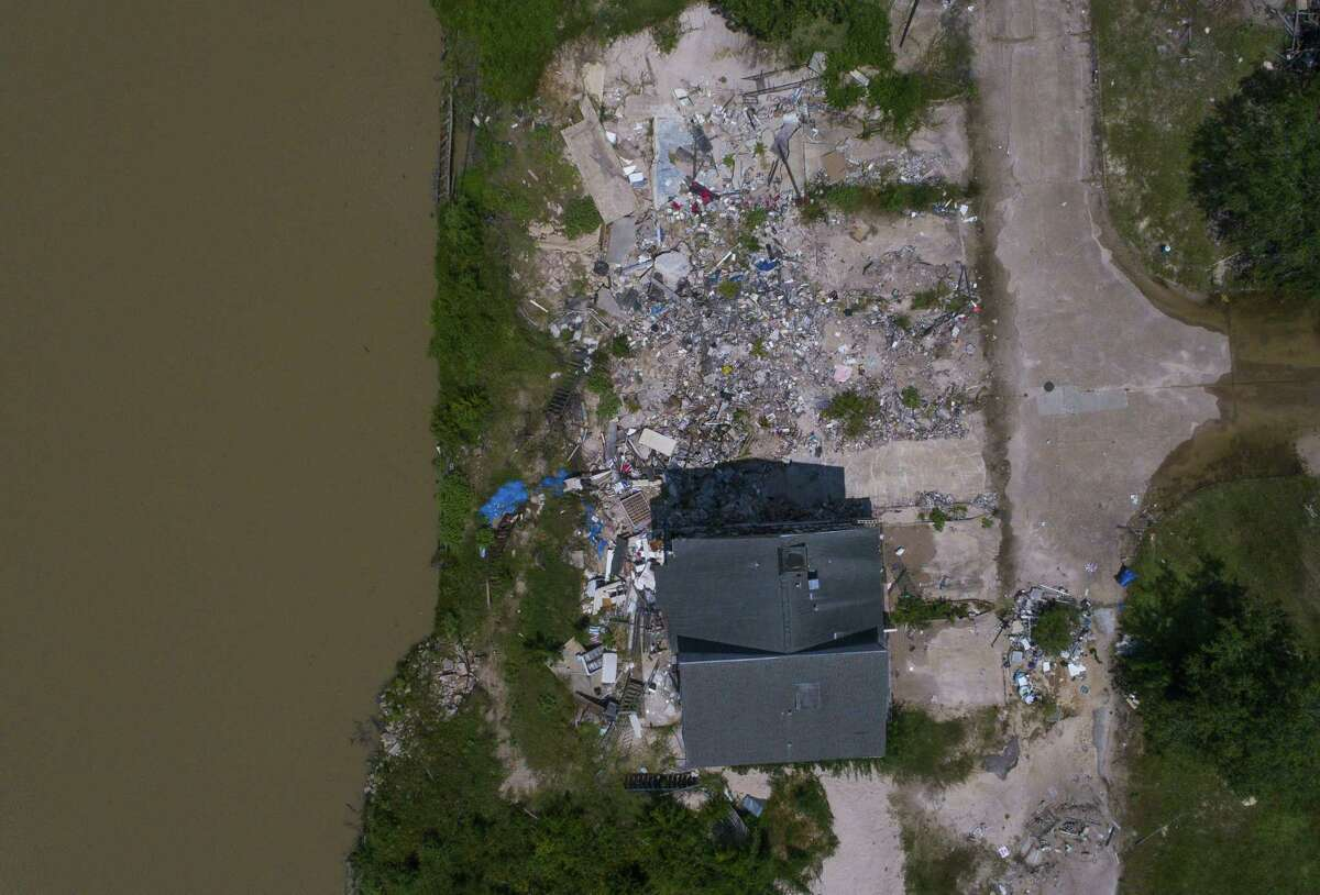 The Harris County Flood Control District plans to purchase and raze more than 100 flood-prone homes on the San Jacinto River, including the Riverview townhouse complex in Kingwood. Hurricane Harvey heavily damaged the property.