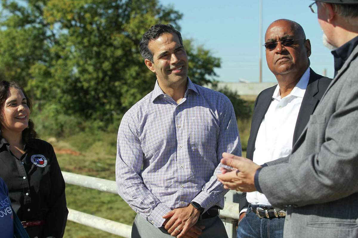 Daphne Lemelle, (l-r) director of Harris County's housing and community development office, Texas General Land Office Commissioner George P. Bush, Harris County Commissioners Rodney Ellis listen to R. Jack Cagle talk about the Harris County Buyout Plans Post Harvey Recovery of Glen Forest Detention Basin on Greens Bayou Friday, Nov. 16, 2018, in Houston.