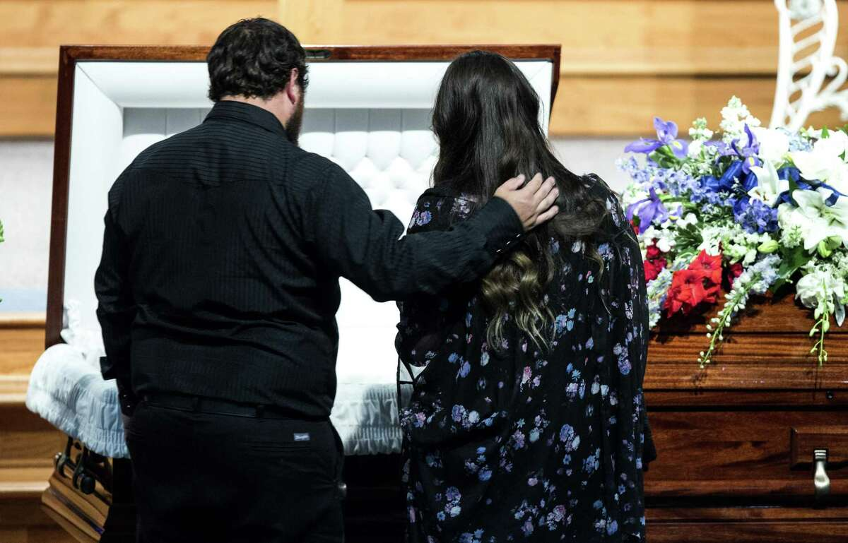 Shannan Claussen, mother of Christian Riley Garcia, is embraced by her husband, D.J. Claussen, during Garcia's funeral at Crosby Church on Friday, May 25, 2018, in Houston. The 15-year-old Santa Fe High School student was one of 10 people killed last Friday, May 18, 2018, during a mass shooting at the school.( Brett Coomer / Houston Chronicle )