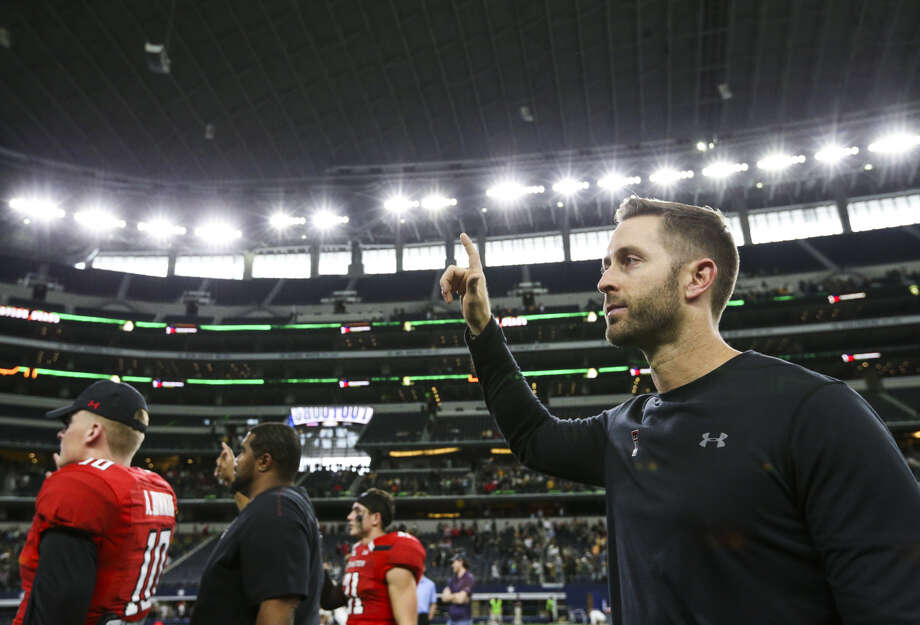 Texas Tech head coach Kliff Kingsbury holds up the Red Raiders hand following Texas Tech's 35-24 loss to Baylor after a football game Saturday, Nov. 24, 2018 at AT&T Stadium in Arlington. Photo: Ryan Michalesko/The Dallas Morning News Via AP