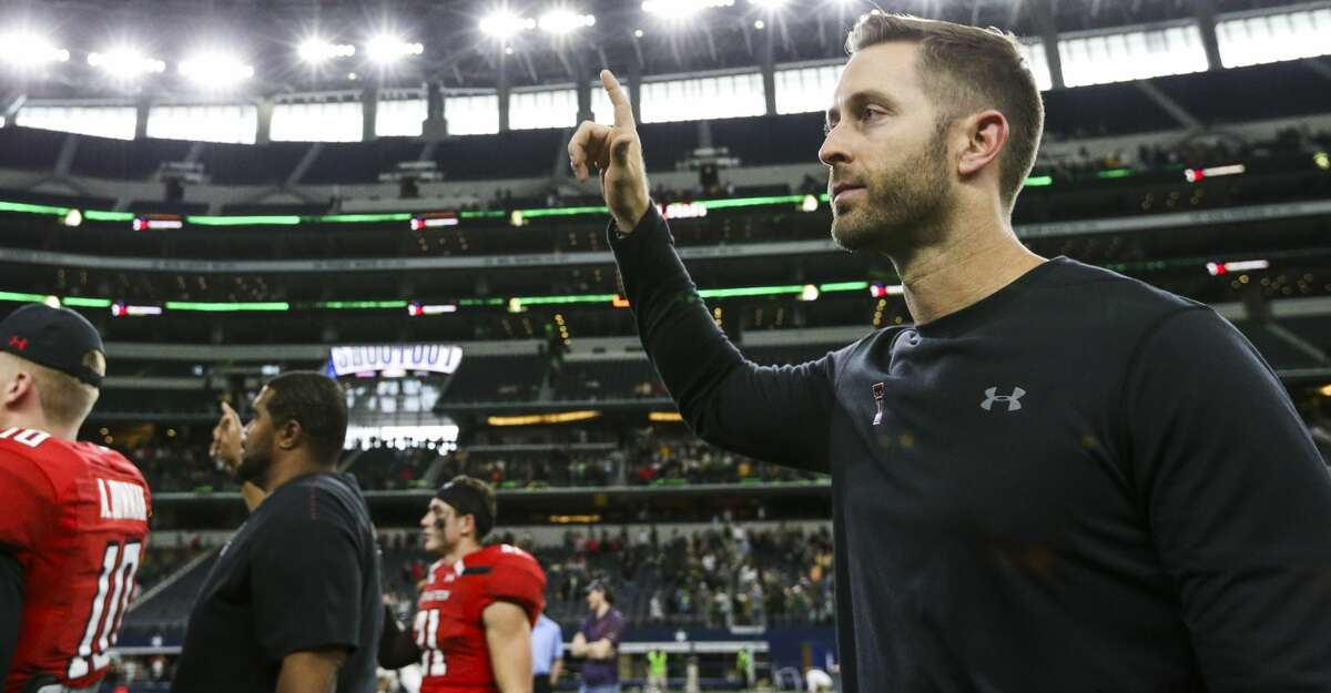 Texas Tech head coach Kliff Kingsbury holds up the Red Raiders hand following Texas Tech's 35-24 loss to Baylor after an NCAA college football game Saturday, Nov. 24, 2018 at AT&T Stadium in Arlington, Texas. Kingsbury has been fired at Texas Tech after the former record-setting Red Raiders quarterback had a losing overall record in his six seasons as their head coach. Athletic director Kirby Hocutt announced the move in a news release Sunday, Nov. 25, 2018. (Ryan Michalesko/The Dallas Morning News via AP)