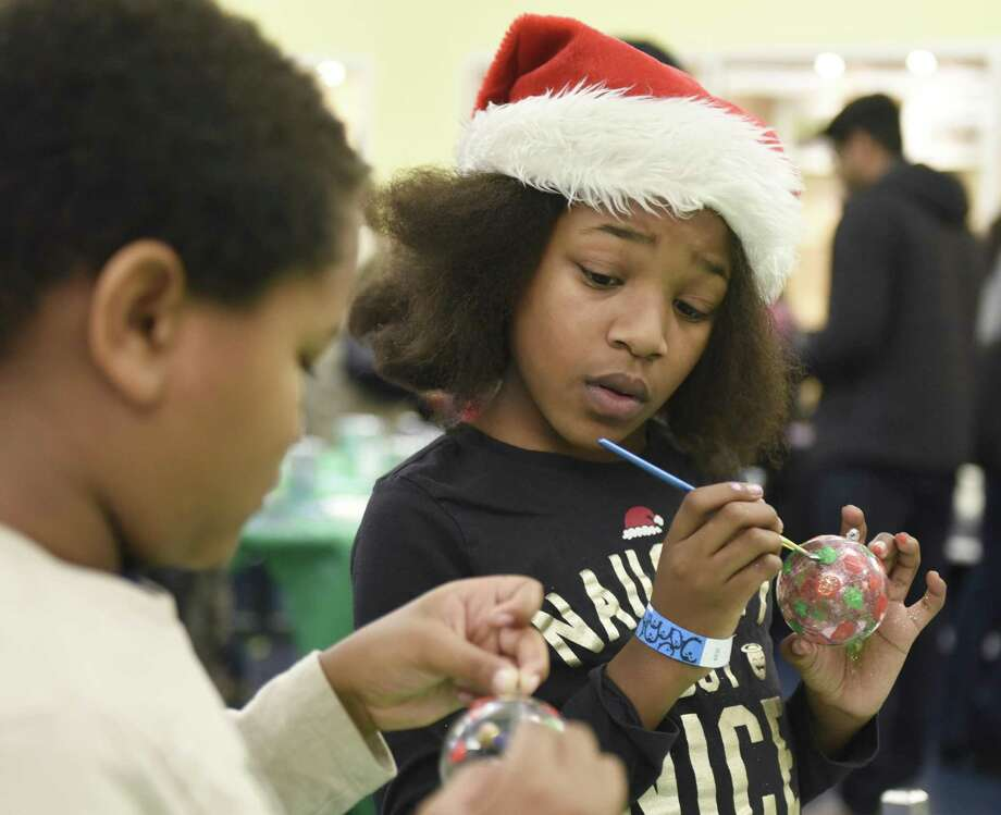 Stamford's Rylie Haynes, 10, decorates Christmas tree balls with her brother, Dashiell, 8, at the Winter Wonderland event at Chelsea Piers in Stamford, Conn. Sunday, Nov. 25, 2018. The event featured holiday movies, a bounce house, craft making, skating and photos with Santa to benefit the Chelsea Piers Scholarship Fund. Photo: Tyler Sizemore / Hearst Connecticut Media / Greenwich Time