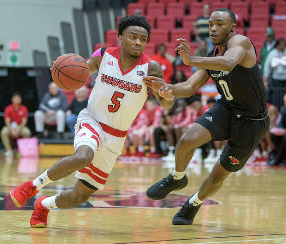 SIUE's Tyreese Williford (left) drives past Incarnate Word's Dwight Murray Jr. during Sunday afternoon's Cougars victory at Vadalabene Center in Edwardsville. Photo: SIUE Athletics