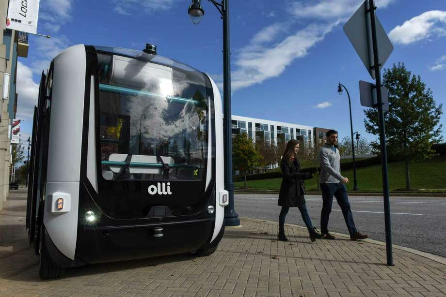 Olli, an automated shuttle, stands outside the offices of Local Motors at National Harbor in Oxon Hill, Md., on Nov. 20. The vehicles run about 10 miles per hour, and are seen as a gateway to greater automation. Photo: Washington Post Photo By Michael Robinson Chavez / The Washington Post
