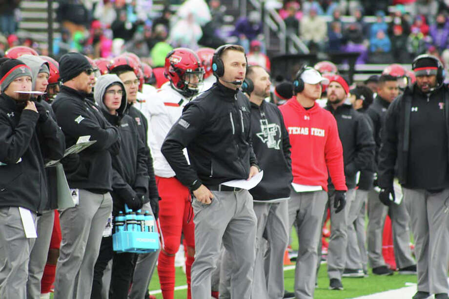 Texas Tech head football coach Kliff Kingsbury (center) stands on the sideline during the Red Raiders' game against Kansas State on Nov. 17 in Manhattan, Kan. Athletics director Kirby Hocutt informed Kingsbury of his firing on Sunday morning. Photo: Devin Ward/KCBD