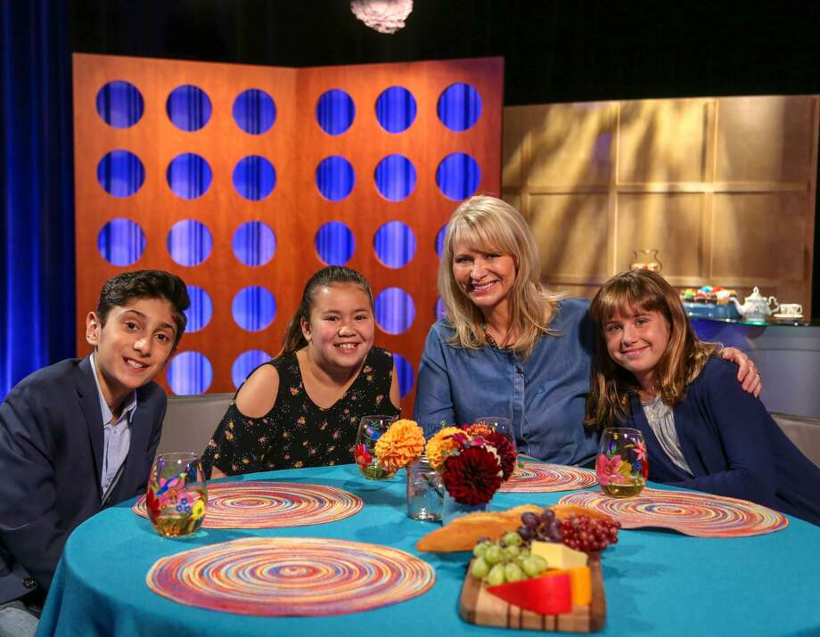 "On the set of ""Check, Please! Bay Area Kids"" are Kian Davani (left), Cole Tao, host Leslie Sbrocco and Maddie Turner. Photo: Grace Cheung / KQED-TV"