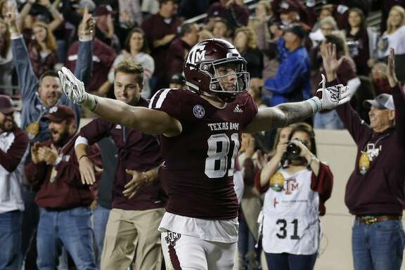 COLLEGE STATION, TEXAS - NOVEMBER 24: Jace Sternberger #81 of the Texas A&M Aggies scores on a 10 yard pass during the second quarter as Grant Delpit #9 of the LSU Tigers is unable to make the stop at Kyle Field on November 24, 2018 in College Station, Texas. (Photo by Bob Levey/Getty Images)