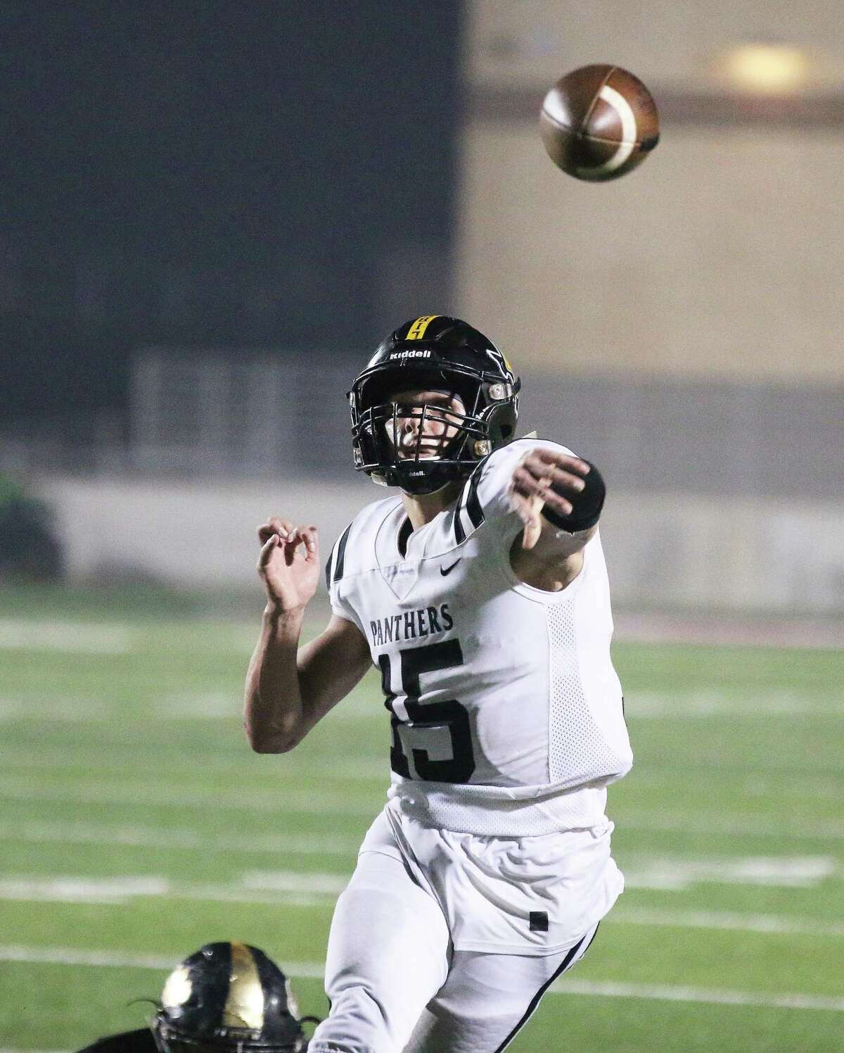 J. J. Slack delivers a bullet pass to Jeremiah Guillory for a Panther touchdown in their playoff game against Giddings Friday night at Texan Drive Stadium in Porter.