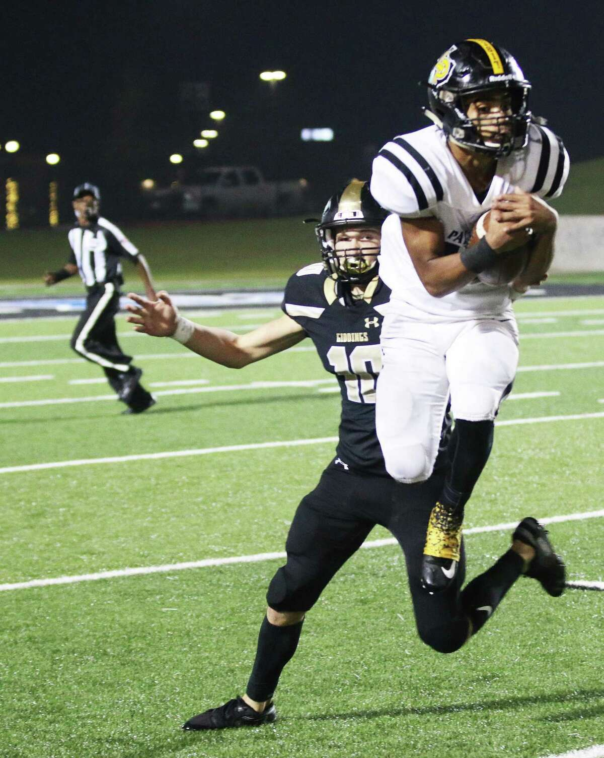 Jeremiah Guillory goes up for a pass from Slack to help the Panthers move the ball down the field Friday night in their Area round playoff game against Giddings.