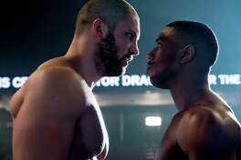 """This image released by Metro Goldwyn Mayer Pictures / Warner Bros. Pictures shows Florian Munteanu , left, and Michael B. Jordan in a scene from """"Creed II."""" (Barry Wetcher/Metro Goldwyn Mayer Pictures/Warner Bros. Pictures via AP)"""