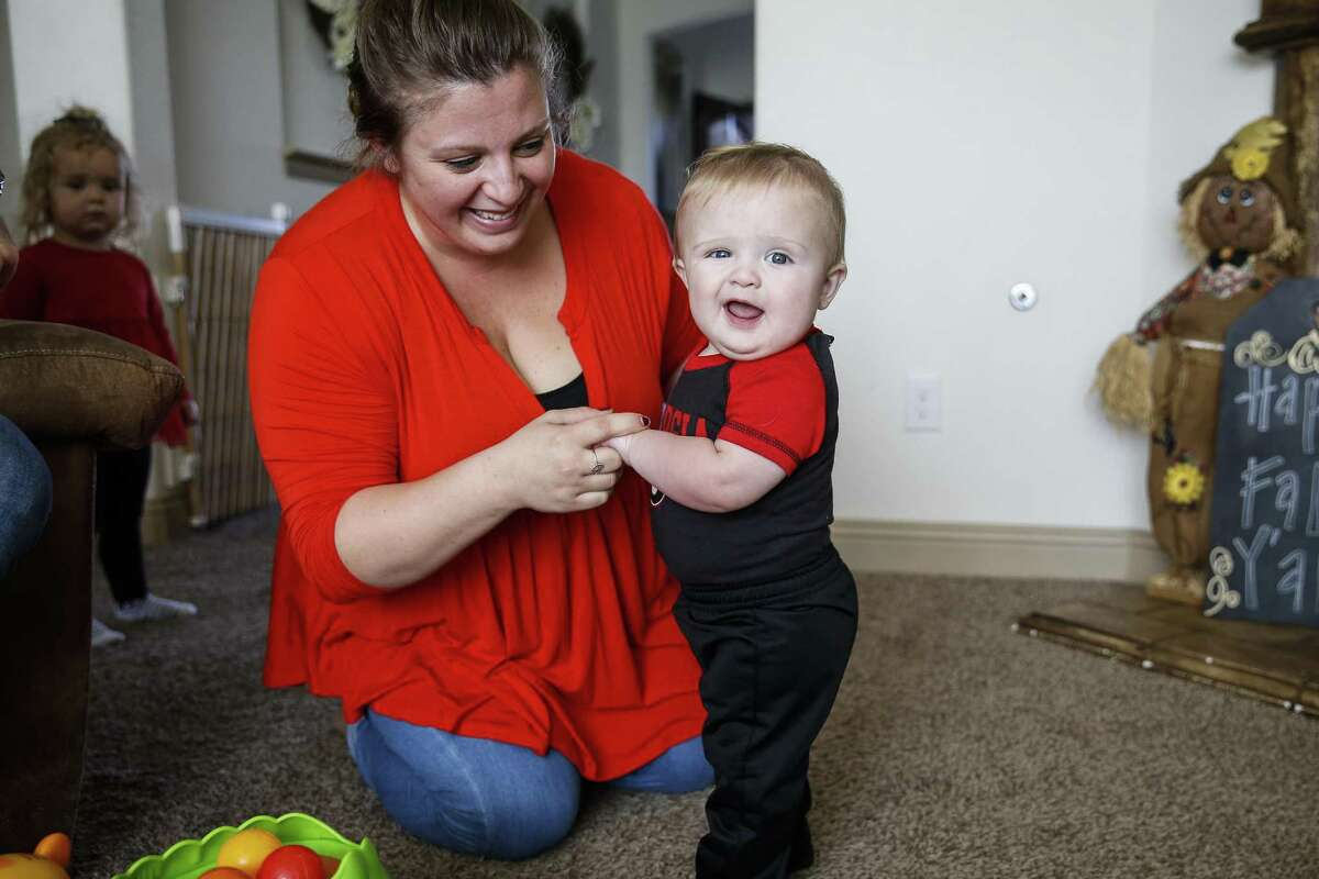 Melissa Bright plays with her nine-month-old son, Mason Bright, Saturday, Nov. 3, 2018, in Tomball. Child Protective Services is facing sanctions after improperly removing the Bright's children from their home after Mason fell and fractured his skull when he was five months old.