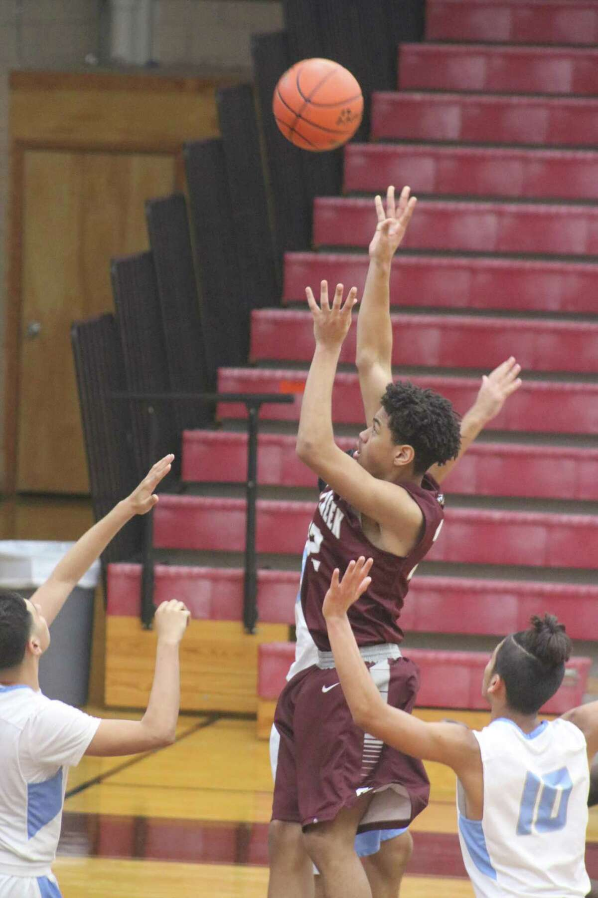 Surrounded by defenders, Clear Creek's J.P. Gonzalez goes up for a shot in the Sam Rayburn game during the Deer park Thanksgiving Tournament this weekend.