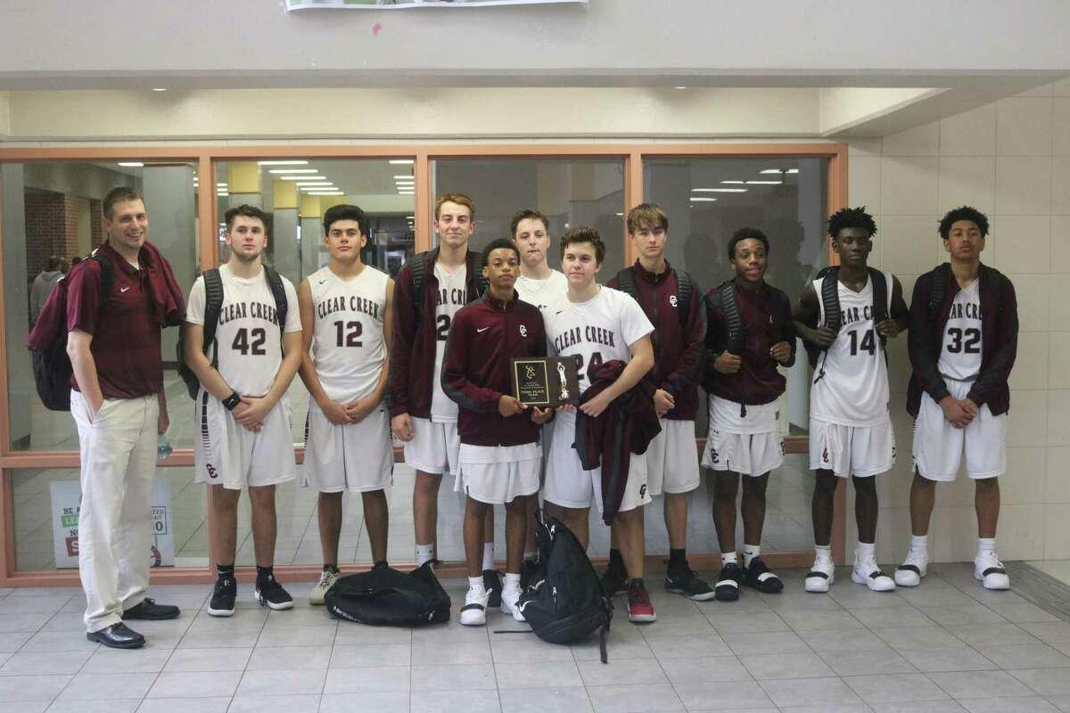 The Clear Creek JV contingent gets together for a team photo after winning third place at the Deer Park Thanksgiving Tournament this weekend.