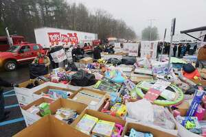 Volunteers unload donated toys from emergency vehicles and trucks during the Saratoga County Sheriff's Office and Capital Region Toys for Tots Convoy for Tots at the Saratoga Performing Arts Center on Sunday, Nov. 25, 2018, in Saratoga Springs, N.Y. This is the fifth year of the Convoy for Tots, and is the largest donation event for the Capital Region Toys for Tots.   (Paul Buckowski/Times Union)