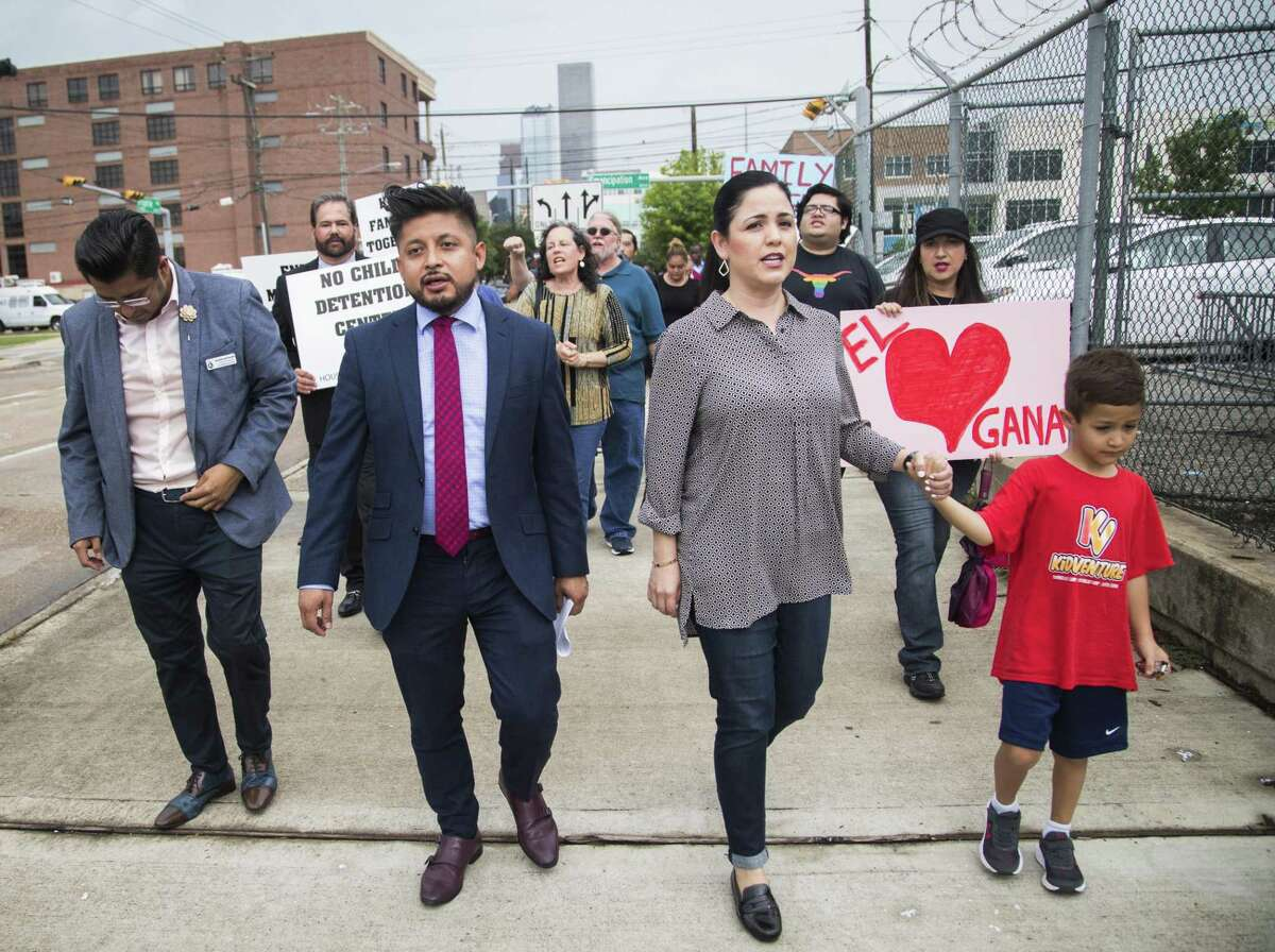 FIEL Houston Cesar Espinosa, Carlos Doroteo, State Representative Ana Hernandez and her son Gregory Luna protest the detention of families seeking asylum, Wednesday, June 20, 2018, in Houston. The activists protested at 419 Emancipation a location considered as a possibility to house detained migrants. ( Marie D. De Jesús / Houston Chronicle )