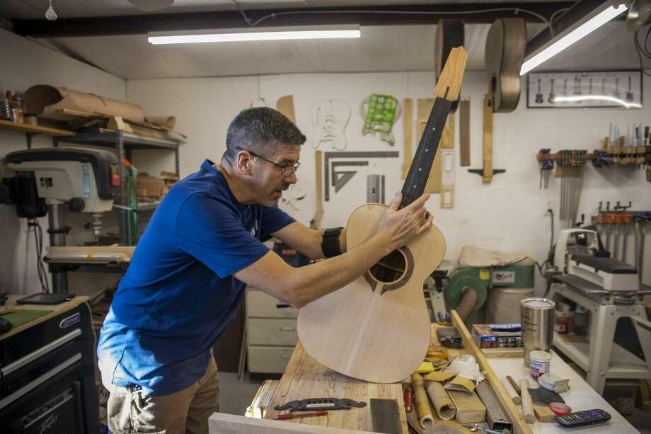 Craig Goodson works on a custom guitar on Nov. 16. 11/16/2018  Jacy Lewis/191 News Photo: Jacy Lewis/191 News