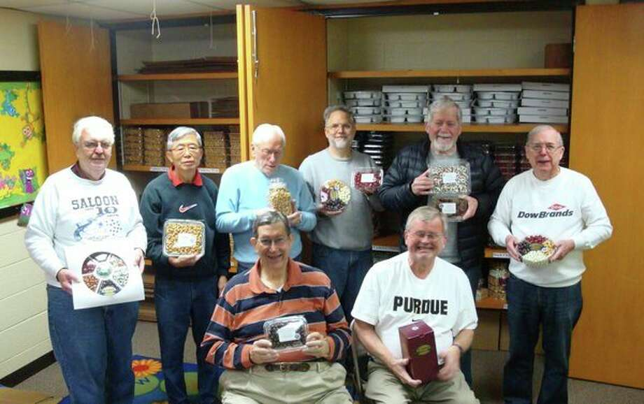 Kiwassee Kiwanians display St. Laurent candy and nut products stocked for the annual fundraiser. Back row, from left, Ray Senesac, Sam Choo, Gordon Rogers, Chuck Gartner, Bruce Rayce and Mike Cronenberger. Front row, from left, Joe Downey and Al Forster. (Photo provided)