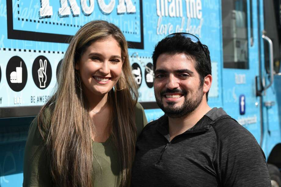 Vanessa Garcia and Miguel Pena pose for a photo during the Hecho a Mano Pop-Up Shop. Photo: Christian Alejandro Ocampo