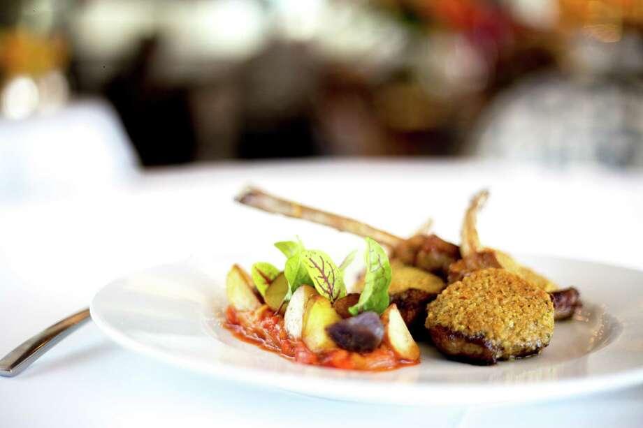 PHOTOS: La Table's new menu explored Yogurt-marinated Colorado lamb chops with piperade at Chateau restaurant at La Table. >>>See more photos from La Table's menu... Photo: Dailey Hubbard