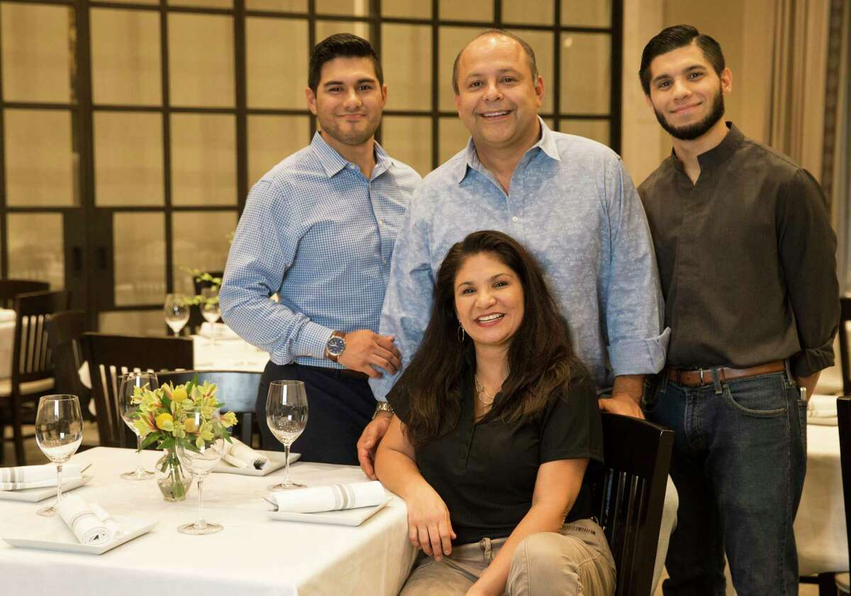 Irma's Southwest Grill owners Louis and Patricia Galvan and their sons Nick Galvan, left, and Jacob Gutierrez at the new Irma's Southwest, 1874 Texas.