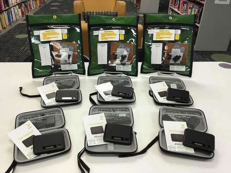 Edwardsville Public Library has recently purchased ten new hotspots now available for cardholders to check out for as long as three weeks at a time. The library now houses 20 devices total equipped with unlimited 4G LTE phone data. Photo: Courtesy Of Edwardsville Public Library Facebook Page