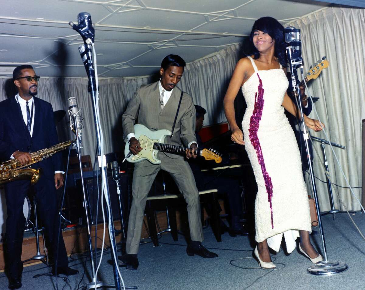 1964: Husband-and-wife R&B duo Ike & Tina Turner perform onstage with a Fender Stratocaster electric guitar in Dallas Fort Worth, Texas. (Photo by Michael Ochs Archives/Getty Images)
