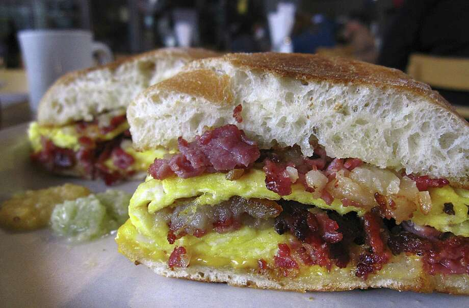 The Hillbilly breakfast sandwich with eggs, cheese and corned beef hash on a telera roll from Panchos & Gringos. Photo: Mike Sutter /Staff