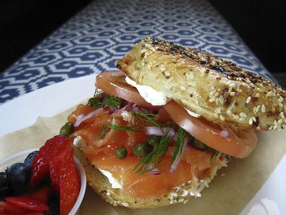 Lox bagel with dill, capers, tomatoes, cream cheese and cured salmon on an everything bagel with a side of fruit from Philoçoffee coffeehouse. Photo: Mike Sutter /Staff