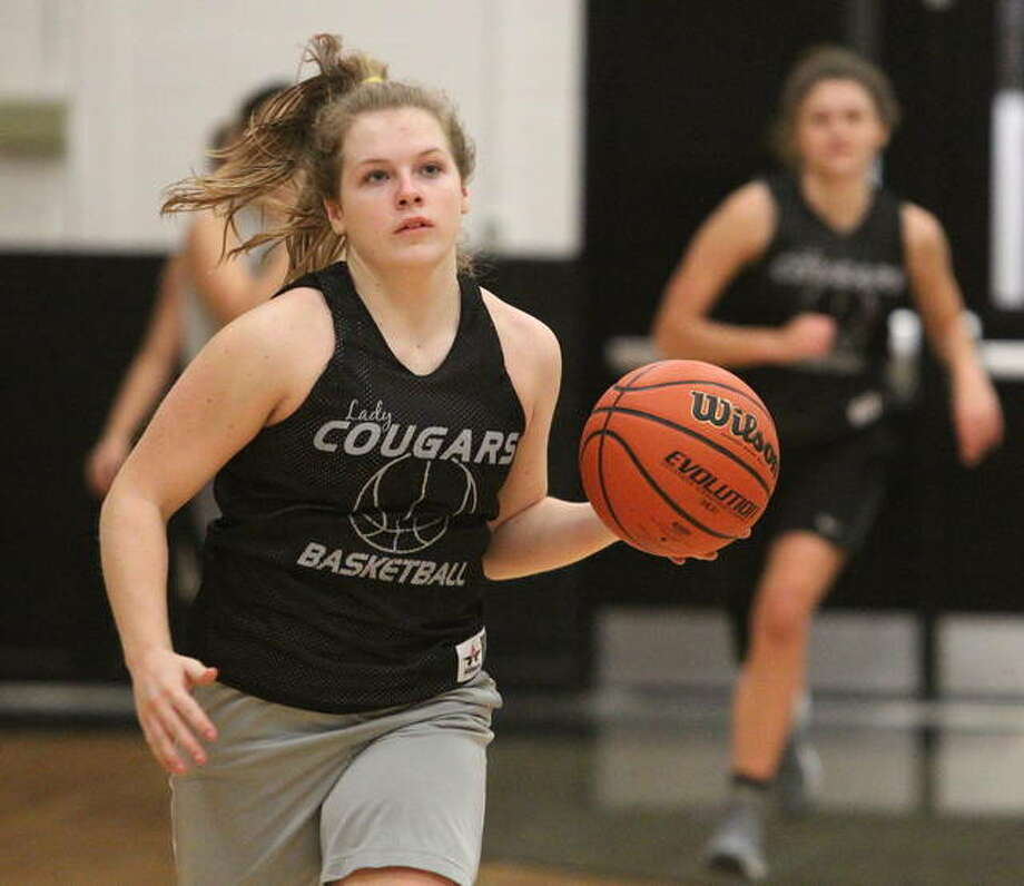 West Central's Zaylei Evans drives to the basket during a recent practice in Bluffs. Evans, a freshman, will be the Cougars' point guard this season. Photo: Dennis Mathes   Journal-Courier