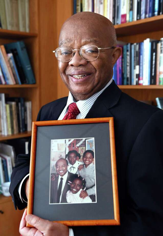 Dr. James Comer of the Yale Child Study Center is photographed on Oct. 29 holding an old picture taken with students at the former Martin Luther King Jr. Elementary School in New Haven. Photo: Arnold Gold / Hearst Connecticut Media / New Haven Register